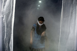 A lady comes out of a sanitisation machine installed at a market in Kolkata midst the 2nd phase of lockdown in India due to covid 19 pandemic. This is to curb the spread of Covid 19 in the country. The second phase is handled with more strict rules by the administration. Kolkata, West Bengal, India, April 28, 2020. Photo by Arindam Mukherjee/ABACAPRESS.COM