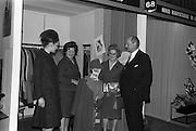 24/04/1964<br /> 04/24/1964<br /> 24 April 1964 <br /> Irish Export Fashion Fair at the Intercontinental Hotel, Dublin. Rose Slowey and Co. Ltd., (Abbey Street, Dublin) stand with model (left) at the fair. Minister for Industry and Commerce, Mr jack Lynch T.D. on right.