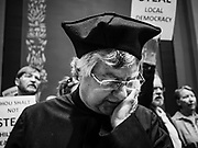 "04 MAY 2017 - ST. PAUL, MN: A Protestant minister prays during a rally supporting workers and women's rights in front of the Minnesota State Senate. About 200 people participated in a ""ISAIAH's 100 Days of Prophetic Resistance"" rally at the Minnesota State Capitol in St. Paul. They represented churches from across the Twin Cities and were demonstrating in favor of paid sick leave, child care, and a higher minimum wage. The Twin Cities are more liberal than rural Minnesota and many Twin Cities municipalities have passed ordinances with paid sick leave, child care and higher minimum wages. Republican legislators from rural Minnesota have tried to pass laws in the legislature rolling back those ordinances.     PHOTO BY JACK KURTZ"
