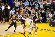 Golden State Warriors forward Kevin Durant (35) battles at the basket against the Houston Rockets at Oracle Arena in Oakland, Calif., on December 1, 2016. (Stan Olszewski/Special to S.F. Examiner)