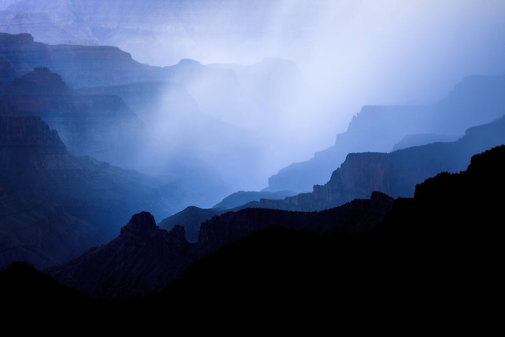 A summer monsoon thunderstorm advances across Bright Angel Canyon in Grand Canyon National Park.