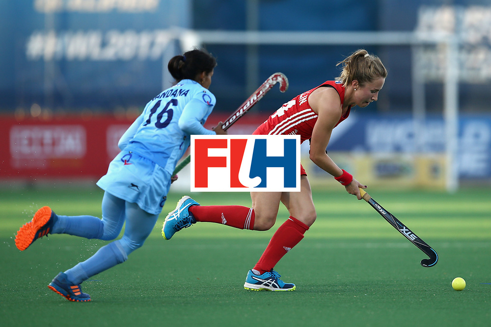 JOHANNESBURG, SOUTH AFRICA - JULY 18: Emily Defroand of England attempts to get away from Renuka Yadav of India during the Quarter Final match between England and India during the FIH Hockey World League - Women's Semi Finals on July 18, 2017 in Johannesburg, South Africa.  (Photo by Jan Kruger/Getty Images for FIH)