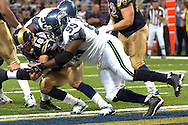 Seattle defensive tackle Rock Bernard (99)sacks St. Louis quarterback Marc Bulger (10) during action at the Edward Jones Dome in St. Louis, Missouri, October 15, 2006.  The Seahawks beat the Rams 30-28.<br />