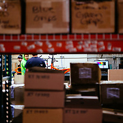 Ibis frames being assembled taken through parts stock on shelves.