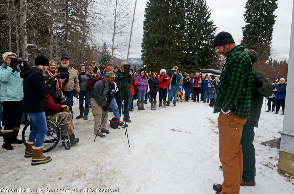 Pete Tallmadge from Troy Montana is introduced as the sawyer selected to cut down the 2017 Capital Christmas Tree at the Historic Upper Ford Ranger Station in the upper Yaak Valley. Kootenai National Forest in the Purcell Mountains, northwest Montana.