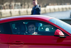 © Licensed to London News Pictures. 11/02/2016. London, UK.  Former Top-Gear presenter RICHARD HAMMOND filming in new red 2016 Ford Mustang GT Coupe sports car on Westminster Bridge in central London. Hammond is currently preparing to take part in a new Amazon Prime television series with former Top-Gear co-hosts Jeremy Clarkson and James May. Photo credit: Ben Cawthra/LNP
