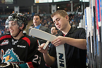 KELOWNA, CANADA - DECEMBER 5: Brendan Hait, equipment manager of the Kelowna Rockets, tapes a stick on the bench against the Prince George Cougars on December 5, 2014 at Prospera Place in Kelowna, British Columbia, Canada.  (Photo by Marissa Baecker/Shoot the Breeze)  *** Local Caption *** Brendan Hait;