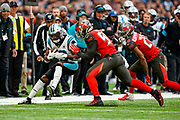 Carolina Panthers Wide Receiver Jarius Wright (13) is pushed out of bounds during the International Series match between Tampa Bay Buccaneers and Carolina Panthers at Tottenham Hotspur Stadium, London, United Kingdom on 13 October 2019.
