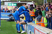 AFC Wimbledon striker Joe Pigott (39) hugs AFC Wimbledon midfielder Scott Wagstaff (7) after an assist during the EFL Sky Bet League 1 match between AFC Wimbledon and Rochdale at the Cherry Red Records Stadium, Kingston, England on 5 October 2019.