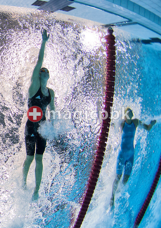 Britta Steffen (L) of Germany competes in the women's 50m Freestyle Heats during the Swimming competition held at the Aquatics Center during the London 2012 Olympic Games in London, England, 3 August 2012.