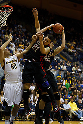Jan 14, 2012; Berkeley CA, USA;  Utah Utes center Jason Washburn (42) and forward Javon Dawson (21) grab a rebound in front of California Golden Bears forward Harper Kamp (22) during the second half at Haas Pavilion. California defeated Utah 81-45. Mandatory Credit: Jason O. Watson-US PRESSWIRE