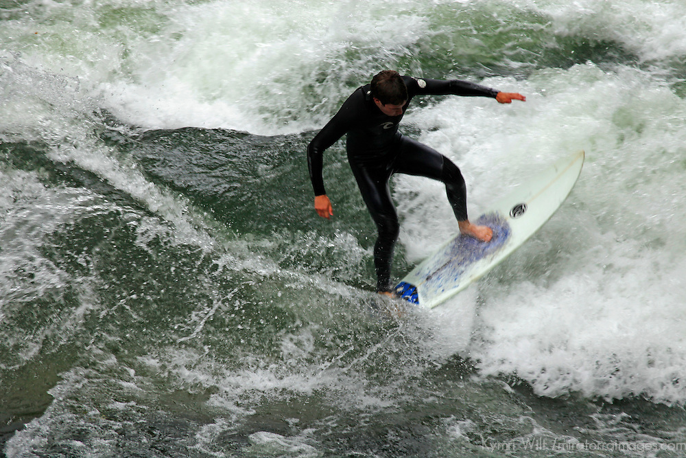 Europe, Germany, Munich. Surfing on the Eisbach River in Munich.