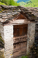 Ticino, Southern Switzerland. An old stone shed in Verdasio with original slate tiles on roof.