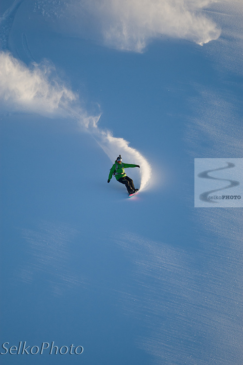 Two time Olympic Champion and  and World Champion boardercross snowboarder Seth Wescott riding for a Warren Miller movie production with Points North Heli Skiing based out of Cordova, AK on April 11, 2011.