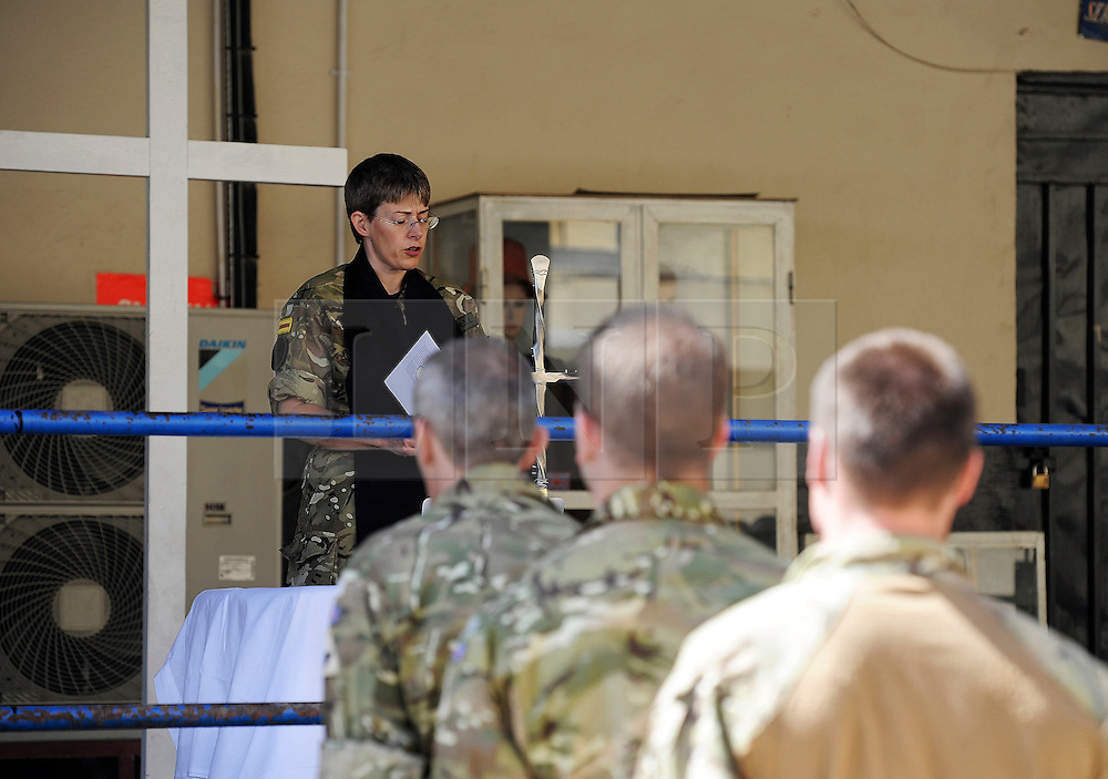 © licensed to London News Pictures. KABUL, AFG  24/04/11. Padre Heather Rendell delivers her sermon. Troops celebrate Easter Sunday in Camp Souter, Kabul today (24 Apr 11).  The unit chaplain, Padre Heather Rendell delivered a ceremony and hymns, using music from her laptop.   Please see special instructions for usage rates. Photo credit should read Sgt Alison Baskerville/LNP