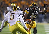 October 10, 2009: Iowa linebacker Jeremiha Hunter (42) tries to get around Michigan quarterback Tate Forcier (5) after an interception during the first half of the Iowa Hawkeyes' 30-28 win over the Michigan Wolverine's at Kinnick Stadium in Iowa City, Iowa on October 10, 2009.