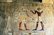 Hatshepsut (1540?-1481?BC) Queen of Egypt, presents offerings to the falcon-headed god Horus. Hatshepsut was always shown as male although a queen.  Medinet Habu, Egypt.
