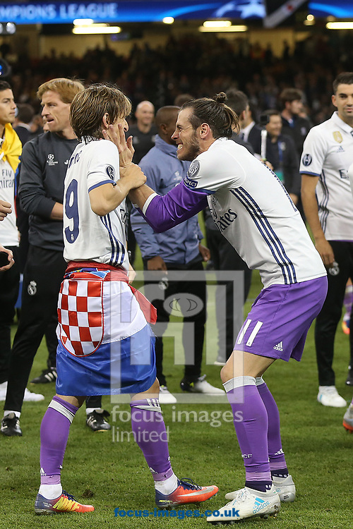 Luka Modric of Real Madrid and Gareth Bale of Real Madrid celebrate victory at the end of the UEFA Champions League Final at the Principality Stadium, Cardiff<br /> Picture by Paul Chesterton/Focus Images Ltd +44 7904 640267<br /> 03/06/2017
