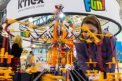 A K'nex roundabout fascinates a visitor to the Toy Fair at Kensington Olympia in London, the UK's largest dedicated game and hobby exhibition featuring the hottest and most anticipated products for the year ahead. London, January 22 2019.