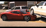 1/02/2011<br /> What happens when you run a huge Ford pickup truck into the front of a brand spanking new Ferrari 458 Italia.  Well, the truck wins as this frustrated driver found out. A video of the bizarre accident has found its way online and shows the front of the F150 climbing up the front of the 2011 Ferrari. The owner said he has only had it a fortnight and had done less that 500 miles.Could it be revenge against Ferrari dubbing their new Formula 1 car, the F150 to mark the companies 150 years anniversary? Or did the trucker simply not see the gleaming red sports machine as it joined a main road in Brandon, Florida from a side road.The Ferrari owner, wearing a yellow Scuderia Ferrari shirt, is seen on the video talking on his mobile phone. A daring cameraman dared to speak to him, and asked: What happened? Looking frustrated, he snapped back: F**ing jetted out and ran on top of my car.He confirmed it was brand new 2011, and that he had it just two weeks. Police are investigating the expensive crash of the 202mph supercar which costs around £150,000.<br /> ©Chris Murphy/Exclusivepix