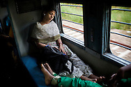 Train passengers nod off to sleep on the Himsagar Express 6318 as it passes through Kerala on 9th July 2009.. .6318 / Himsagar Express, India's longest single train journey, spanning 3720 kms, going from the mountains (Hima) to the seas (Sagar), from Jammu and Kashmir state of the Indian Himalayas to Kanyakumari, which is the southern most tip of India...Photo by Suzanne Lee / for The National