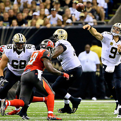Sep 20, 2015; New Orleans, LA, USA; New Orleans Saints quarterback Drew Brees (9) throws against the Tampa Bay Buccaneers during the second quarter of a game at the Mercedes-Benz Superdome. Mandatory Credit: Derick E. Hingle-USA TODAY Sports