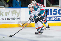 KELOWNA, CANADA - FEBRUARY 14: Nick Merkley #10 of Kelowna Rockets skates with the puck against the Moose Jaw Warriors on February 14, 2015 at Prospera Place in Kelowna, British Columbia, Canada.  (Photo by Marissa Baecker/Shoot the Breeze)  *** Local Caption *** Nick Merkley;