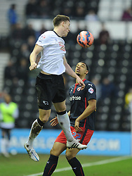 Derby Craig Forsyth beats reading Nick Blackman, Derby County v Reading, FA Cup 5th Round, The Ipro Stadium, Saturday 14th Febuary 2015