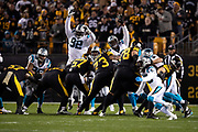 Carolina Panthers defensive tackle Vernon Butler (92) and Carolina Panthers defensive tackle Kawann Short (99) leap while trying to block a kick during the NFL week 10 regular season football game against the Pittsburgh Steelers on Thursday, Nov. 8, 2018 in Pittsburgh. The Steelers won the game 52-21. (©Paul Anthony Spinelli)