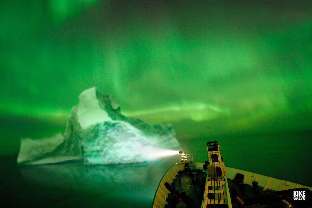 Northern lights or Aurora borealis on the Arctic night sky, viewed from Orlova Russian Icebreaker, High Arctic. Canada<br /> ( night, nocturnal, show, colorful, green, red, spectacule, weather, atmosphere,
