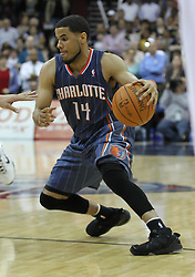 Apr 11; Newark, NJ, USA; Charlotte Bobcats point guard D.J. Augustin (14) dribbles the ball during the second half at the Prudential Center. The Bobcats defeated the Nets 105-103.