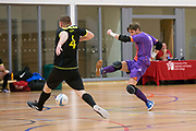 Dundee Futsal goalkeeper Kamil Kajetaniak plays rush goalie and has an effort at goal v TMT (black) in the Scottish Futsal Finals day semi final at Perth College, Perth, Photo: David Young<br /> <br />  - © David Young - www.davidyoungphoto.co.uk - email: davidyoungphoto@gmail.com