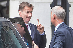 © Licensed to London News Pictures. 18/06/2019. London, UK. Foreign Secretary and leadership candidate Jeremy Hunt gestures as he arrives at Parliament ahead of the second round of leadership votes. Boris Johnson has cemented his position as favourite to become the next Prime Minster after winning a clear majority in the first round of the conservative party's leadership race. Photo credit: Peter Macdiarmid/LNP