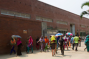 Garment workers arrive and leave the factory during a staggered lunch break at Epyllion Group garment factory in Bangladesh. <br /> <br /> Workers get an hour for their lunch break.
