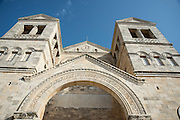 Exterior of the Franciscan church of the Transfiguration, mount Tabor, Jezreel Valley, Galilee, Israel (architect Antonio Barluzzi 1924). Latin inscription over the door