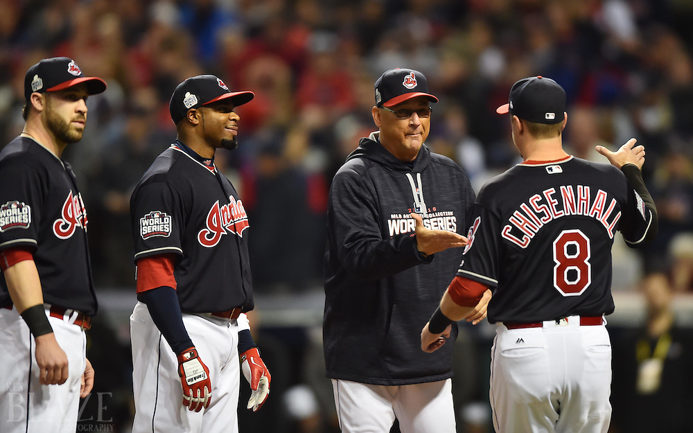 Oct 25, 2016; Cleveland, OH, USA; Cleveland Indians manager Terry Francona greets right fielder Lonnie Chisenhall (8) before game one of the 2016 World Series against the Chicago Cubs at Progressive Field. Mandatory Credit: Ken Blaze-USA TODAY Sports
