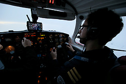 NORWAY BARENTS SEA 6DEC15 - Air taxi pilots in the cockpit of their Piper PA31-350 Navajo  above the Barents Sea, north of Norway.<br /> <br /> jre/Photo by Jiri Rezac / Greenpeace<br /> <br /> © Jiri Rezac 2015