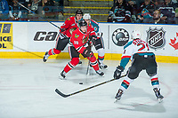 KELOWNA, CANADA - APRIL 8: Devante Stephens #21 of the Kelowna Rockets blocks a shot by Matt Revel #18 of the Portland Winterhawks on April 8, 2017 at Prospera Place in Kelowna, British Columbia, Canada.  (Photo by Marissa Baecker/Shoot the Breeze)  *** Local Caption ***