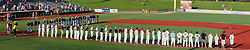 11 July 2012:   Players, coaches, umpires and mascots line up on the field for the playing of the Canadian and United States National Anthems during the Frontier League All Star Baseball game at Corn Crib Stadium on the campus of Heartland Community College in Normal Illinois