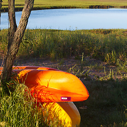 Kayaks next to a salt marsh in Provincetown, Massachusetts.