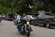 "Rico Garcia, president of the Thin Blue Line Foundation and Law Enforcement Motorcycle Club, arrives at Stevens ES for ""Bikes for Excellence."""