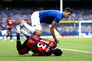 Bournemouth forward Callum Wilson (13) and Everton defender Michael Keane  collide during the Premier League match between Everton and Bournemouth at Goodison Park, Liverpool, England on 26 July 2020.
