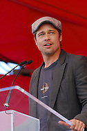 Photograph of actor Brad Pitt speaks at a press conference in the Lower Ninth Ward on behalf of the Make it Right Foundation in New Orleans, LA.