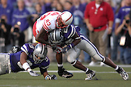 Nebraska wide receiver Terrence Nunn (83) gets hit by Kansas State defenders Justin McKinney (22) and Kyle Williams (9) in the first half at Bill Snyder Family Stadium in Manhattan, Kansas, October 14, 2006.  The Huskers beat the Wildcats 21-3.<br />
