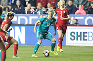 CHESTER, PA - MARCH 01: Lena Petermann (GER) (18) is watched by Morgan Brian (USA) (6) and Samantha Mewis (USA) (3). The United States Women's National Team played the Germany Women's National Team as part of the She Believes Cup on March 1, 2017, at Talen Engery Stadium in Chester, PA. The United States won the game 1-0.