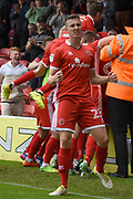 Walsall midfielder Shaun Donnellan (23) celebrates Walsall midfielder Erhun Oztumer (10) goal to make it 2-1 during the EFL Sky Bet League 1 match between Walsall and Oldham Athletic at the Banks's Stadium, Walsall, England on 12 August 2017. Photo by Alan Franklin.