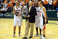20 March 2010: Carrie Snikkers, Coach Brian Morehouse Philana Greene and Jenny Cowen stand with the trophy and game ball. The Flying Dutch of Hope College fall to the Bears of Washington University 65-59 in the Championship Game of the Division 3 Women's NCAA Basketball Championship the at the Shirk Center at Illinois Wesleyan in Bloomington Illinois.
