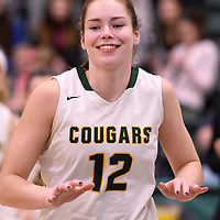 4th year forward Christina McCusker (12) of the Regina Cougars in action during the Women's Basketball home game on January  19 at Centre for Kinesiology, Health and Sport. Credit: Arthur Ward/Arthur Images
