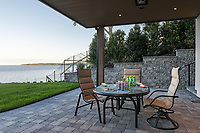 Building contractor Falcon Heights builds a new home on a seaside lot in Cordova Bay, Victoria, BC that features arched vaulted ceilings, beautiful craftsmanship and ocean views.