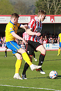George Maris and Jack Barthram during the Vanarama National League match between Cheltenham Town and Lincoln City at Whaddon Road, Cheltenham, England on 30 April 2016. Photo by Antony Thompson.